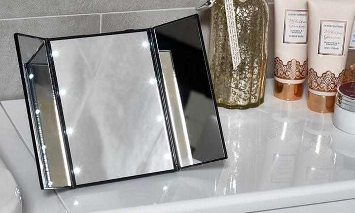 tri-fold mirror with eight led lights