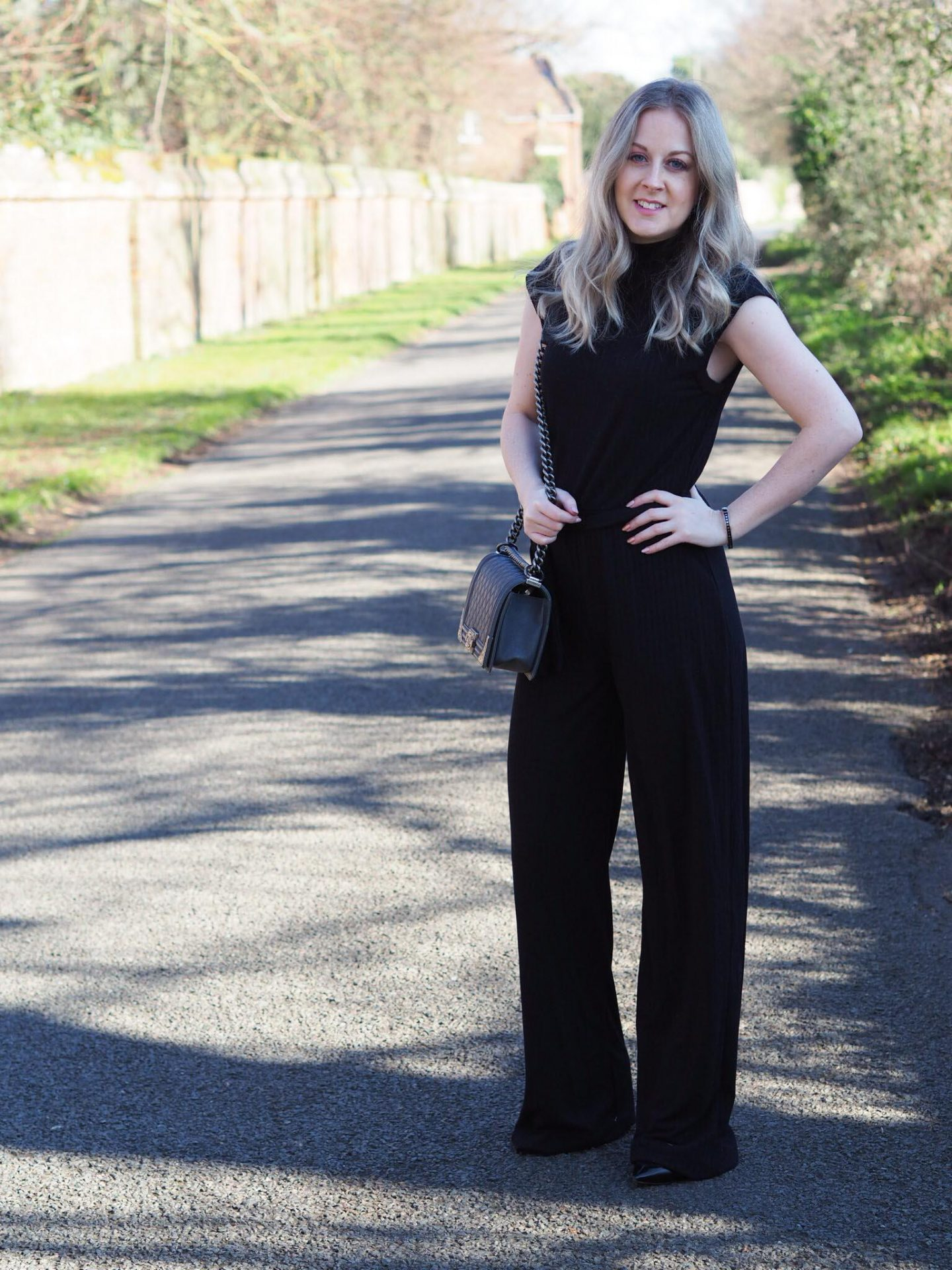 Femme Luxe black high neck ribbed jumpsuit